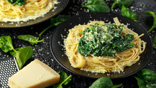 Tagliatelle Pasta With Spinach In Cream Sauce With Parmesan