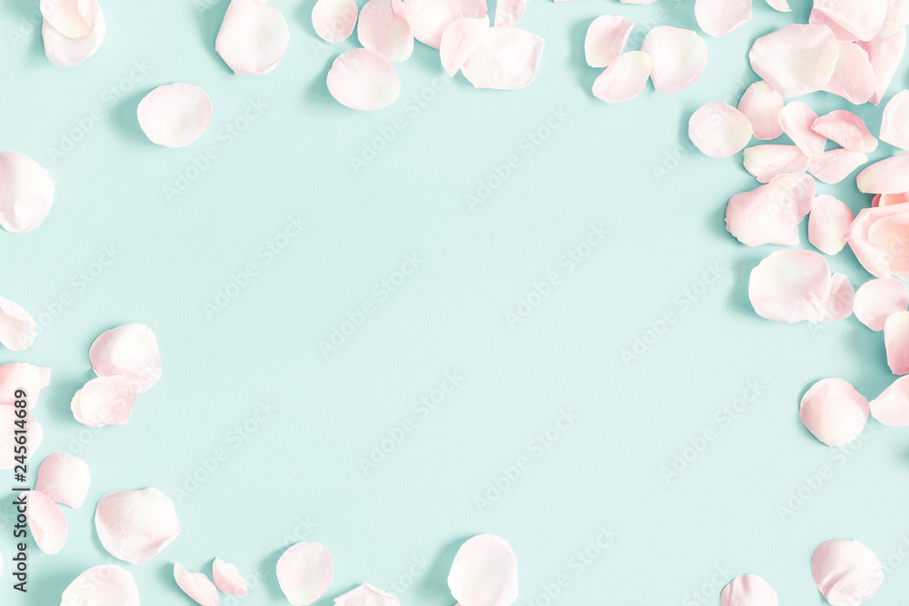 Fototapeta Flowers composition. Rose flower petals on pastel blue background. Valentine's Day, Mother's Day concept. Flat lay, top view, copy space