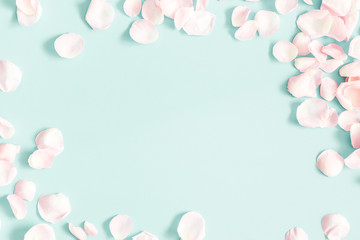 Flowers composition. Rose flower petals on pastel blue background. Valentine's Day, Mother's Day concept. Flat lay, top view, copy space