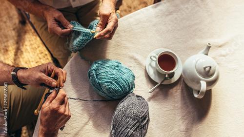 Senior people knitting at home