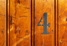 Number 4 On Door Of Storage Room For Tenants In Century-old Apartment Building In Stockholm