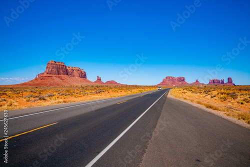 Poster Route 66 Endless infinite road that goes through the Monument Valley National park with amazing rock formations.
