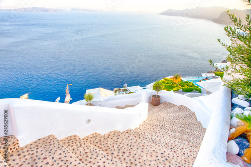 Montage in der Fensternische Santorini Travel Destinations.Picturesque Cityscape of Oia Village in Santorini with Volcanic Caldera and sailing Boats on Background.