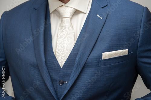 Fototapeta Grooms morning preperation closeup, blue suit obraz