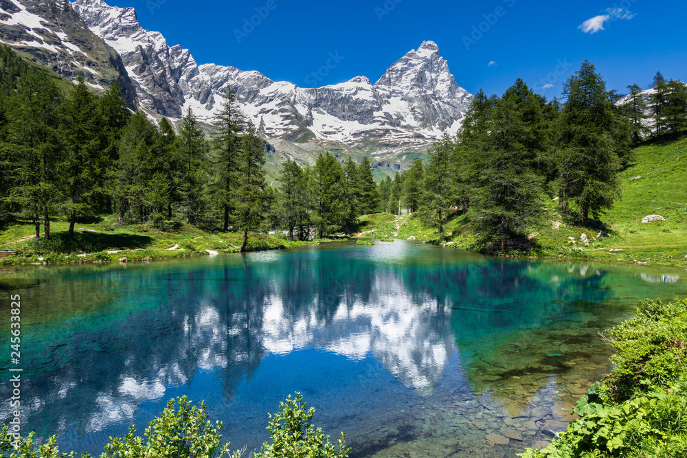 Fototapety, obrazy: Summer alpine landscape with the Matterhorn (Cervino) reflected on the Blue Lake (Lago Blu) near Breuil-Cervinia, Aosta Valley, northern Italy