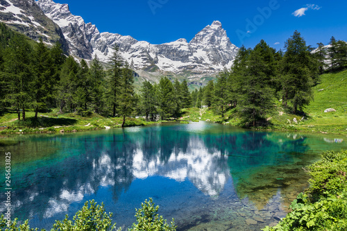 Aluminium Prints Alps Summer alpine landscape with the Matterhorn (Cervino) reflected on the Blue Lake (Lago Blu) near Breuil-Cervinia, Aosta Valley, northern Italy