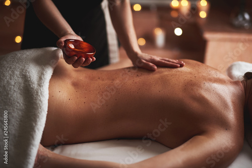 Poster Spa Massage therapist pour essential oil out from bowl