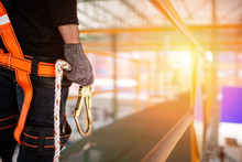 Construction Worker Wearing Safety Harness And Safety Line
