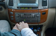 touching the hands of men and women, on the background of controls, receiver and car panel