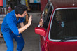 auto service, repair, maintenance concept mechanic with clipboard and car owner businessman. excellent service,safe driving