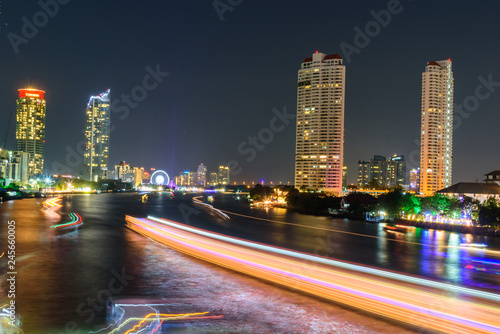 Foto op Plexiglas Stad gebouw blur light of boat moving at the river of City