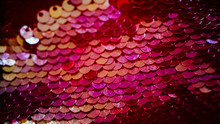 Glittering Fabric Design. Red Gradient Sequin Background.