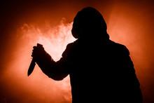 A Dangerous Hooded Man Standin...