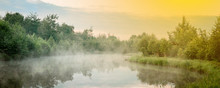 Sunrise With Mist Over A Lake At The Wetlands