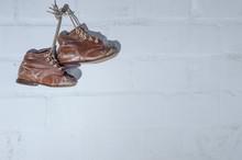 Old, Worn Children's Shoes Han...
