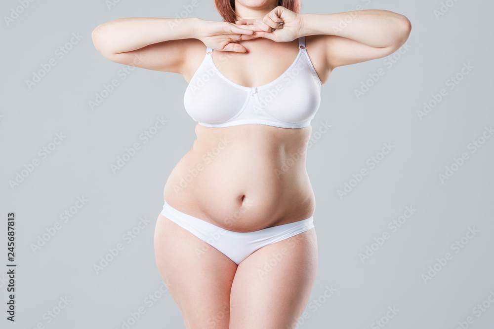 Fototapety, obrazy: Woman with fat abdomen, overweight female body on gray background