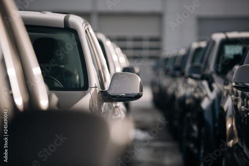 Fototapeta A lot of modern suv pickup at the parking