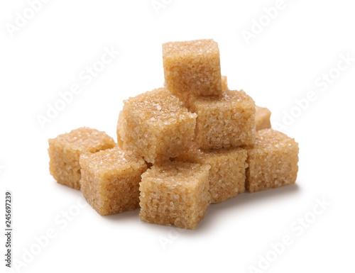 Tela Heap of cane sugar cubes isolated on white background