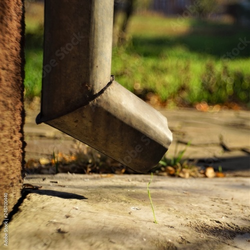 Fotografia, Obraz  Bottom of the drain pipe at the corner of the house