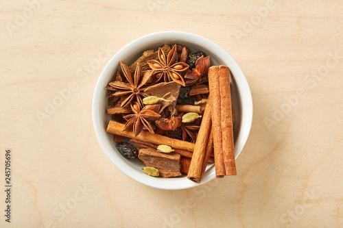 Obraz Spice for tea, coffe, baking in bowl on wooden table.  - fototapety do salonu