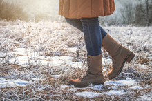 Woman Wearing Leather Hiking Boots In Winter Frozen Nature
