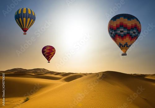 Desert and hot air balloon Landscape at Sunrise.