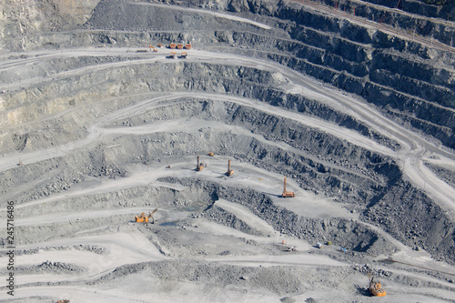 Poster Taupe Aerial view industrial of opencast mining quarry with lots of machinery at work