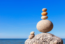 Rock Zen Pyramid Of Colorful Pebbles On A Beach On The Background Of The Sea. Concept Of Balance, Harmony And Meditation.