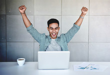 Small Business And Successful Concept. Young Asian Businessman Glad To Recieve A Good News Or High Profits From Computer Laptop, Own Business Achieves Goals. Raising Arms To Celebrating Success
