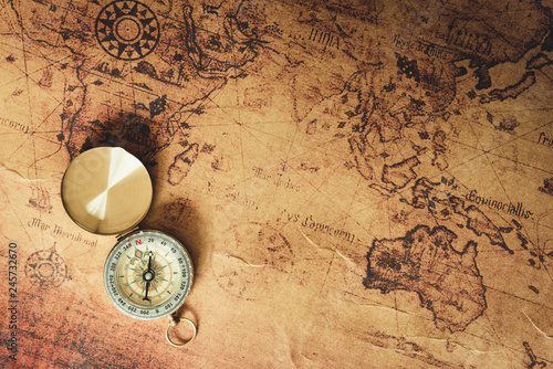 Navigator explore journey with compass and world map Fototapet