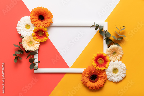 Tuinposter Gerbera Happy Mother's Day, Women's Day, Valentine's Day or Birthday Living Coral Pantone Color Background. Coral flat lay greeting card template with beautiful gerbera flowers.