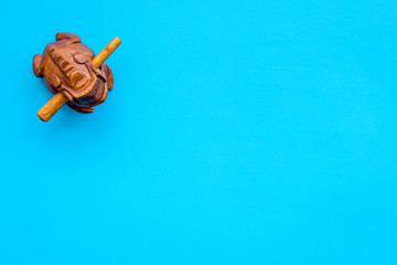 Buddhist symbol. Oriental wooden frog on blue background top view space for text