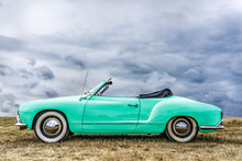 Side View Of A Beautiful Green European Covertible. The Roof Of This Beautiful Ghia Karmann Is Open