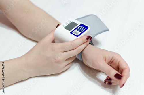 Fotografie, Obraz  Tonometer on a female hand. Blood pressure measuring concept.