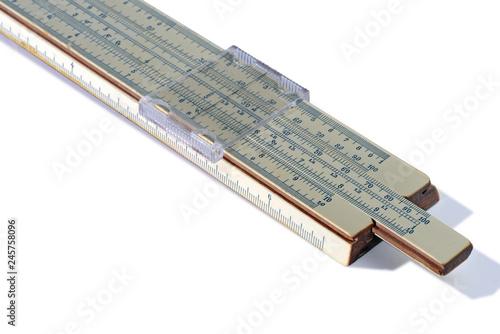 Old slide rule isolated on white background. Vintage logarithmic ruler