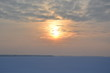 Sunset over the ice of the Curonian lagoon