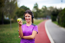 Positive Fitness Woman Holding Green Apple