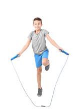 Full Length Portrait Of Boy Jumping Rope On White Background