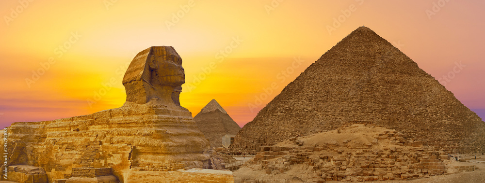 Fototapety, obrazy: Sphinx against the backdrop of the great Egyptian pyramids. Africa, Giza Plateau.