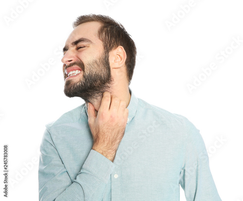Fotografia Young man scratching beard on white background. Annoying itch
