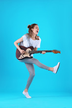 Young Woman Playing Electric G...