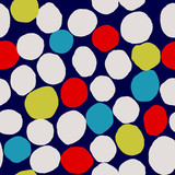 Abstract seamless pattern with irregular dots in blue, yellow, cream and red on dark blue background. - 245785096