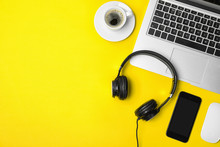 Flat Lay Composition With Headphones, Smartphone, Laptop And Space For Text On Color Background