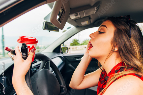 Valokuvatapetti Young recklessly woman in car doing make up