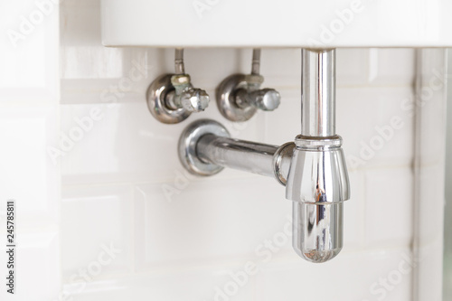 Valokuva  Basin siphon or sink drain in a bathroom, clean