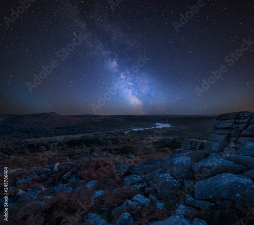 Poster Prune Stunning vibrant Milky Way composite image overBeautiful Autumn sunset landscape image of view from Leather Tor towards Burrator Reservoir in Dartmoor National Park