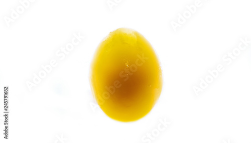 Fototapeta frozen yolk in broken and peeled egg on an isolated white background obraz na płótnie