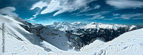 Fototapeta Panorama of High Tatras winter above the clouds obraz