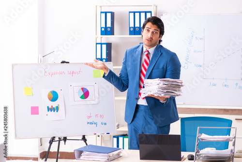 Fototapety, obrazy: Male sales analyst in front of the whiteboard