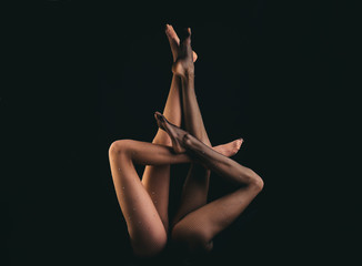 Tights on black background. Black tights, beautiful female legs. Shapely female legs in black tights. Legs of beautiful young woman in black tights